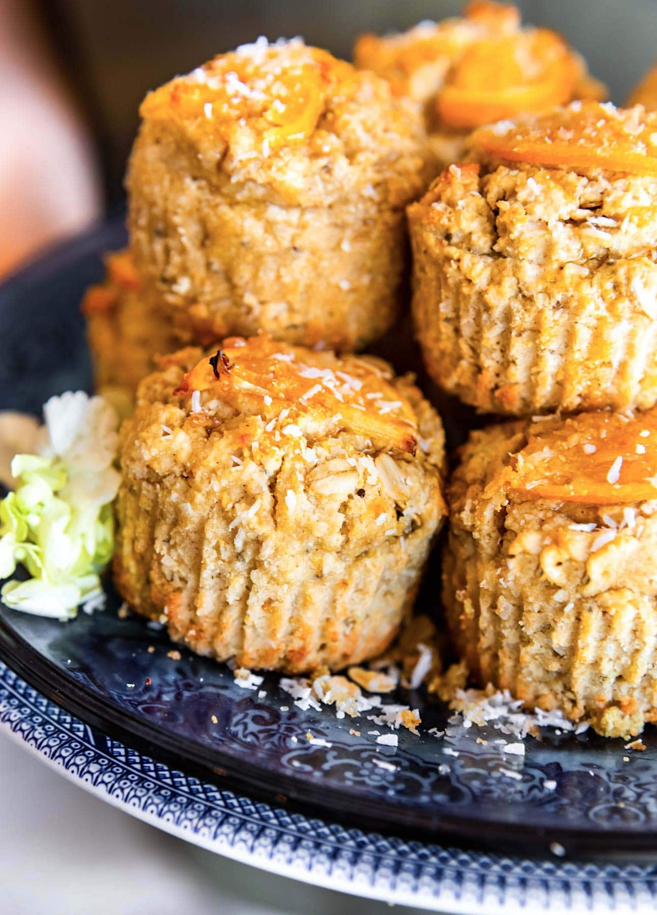 stack of orange coconut muffins on plate