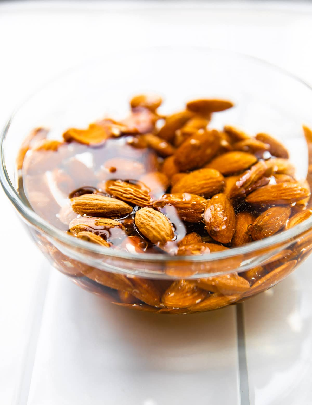 photo shows how to make nut milk by soaking almonds in water