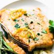 healthy baked salmon filet with maple dijon glaze on white plate