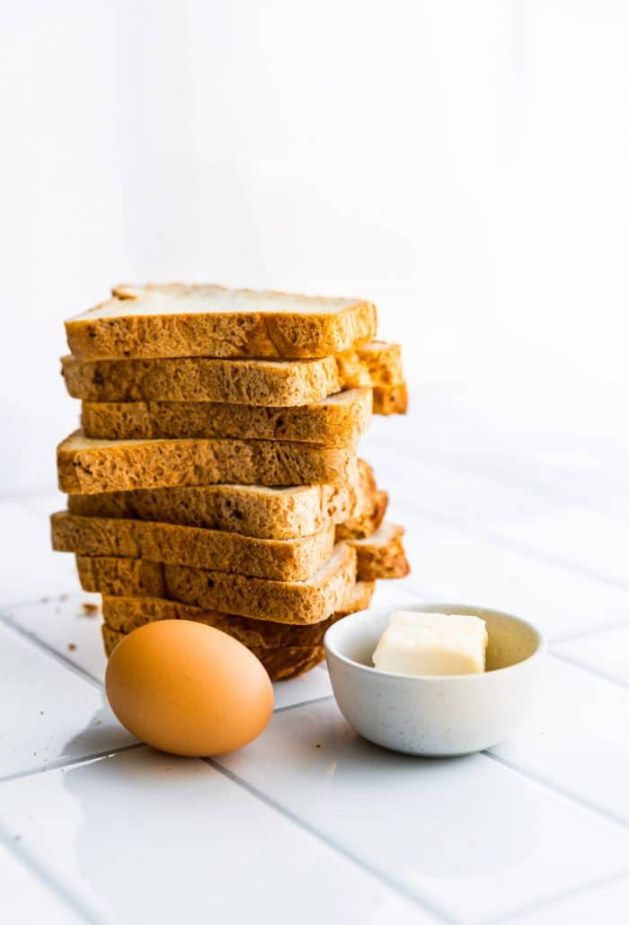stack of gluten free bread, an egg, and butter to make 3 ingredient pie crust recipe