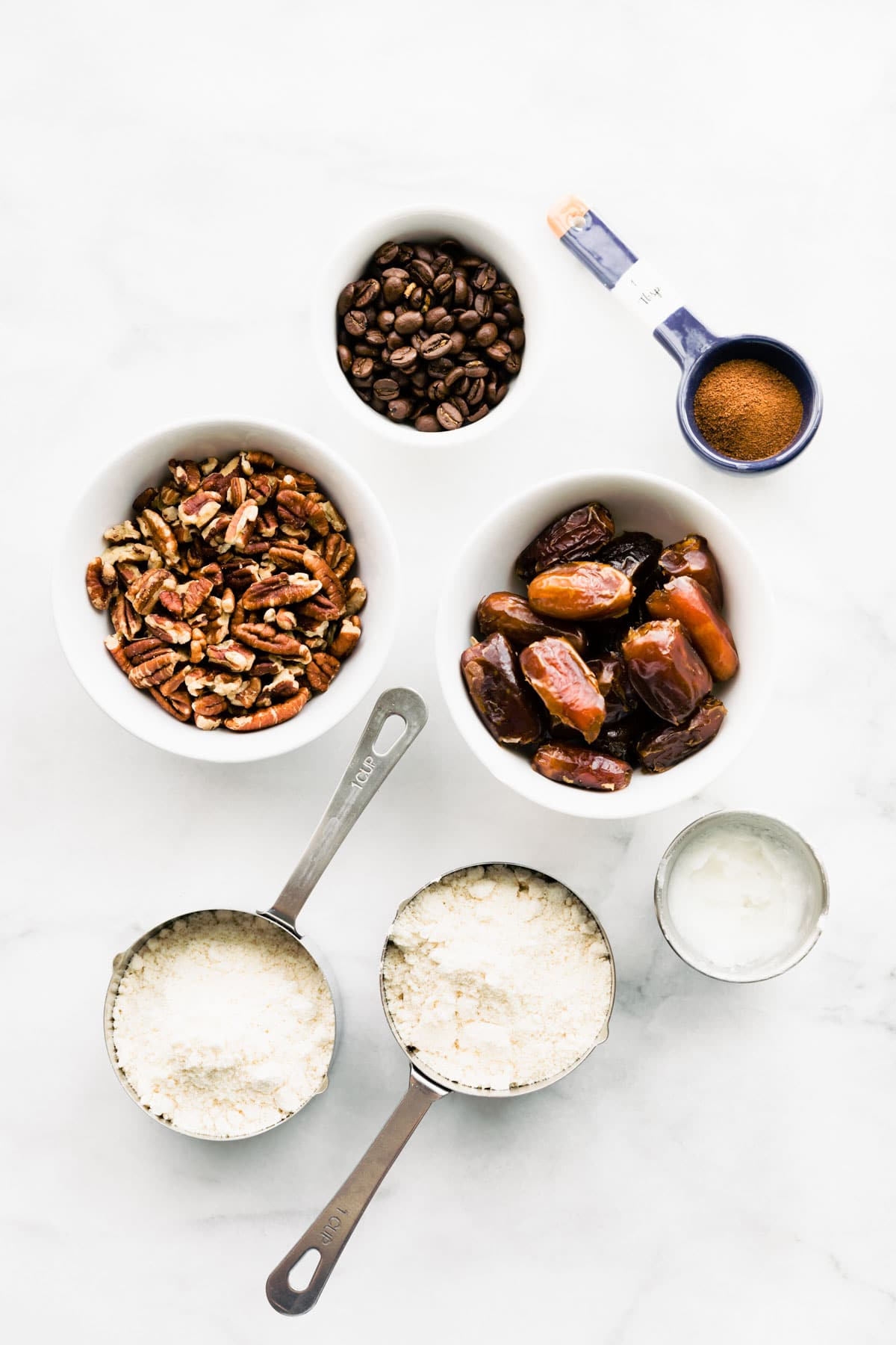overhead: ingredients in bowls and measuring cups to make pecan pie bar recipe