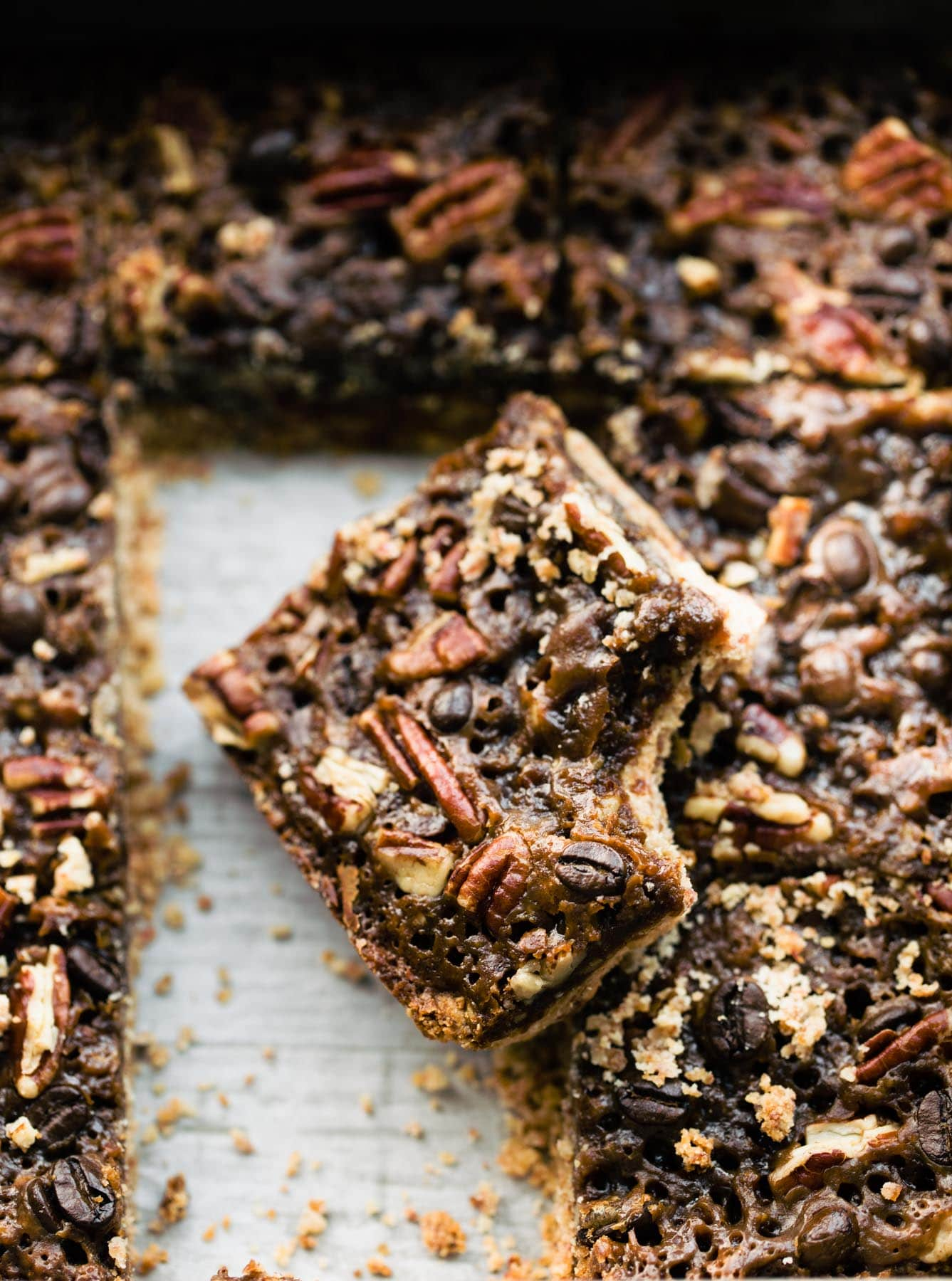 pan of pecan date bar cookies, one with bite removed