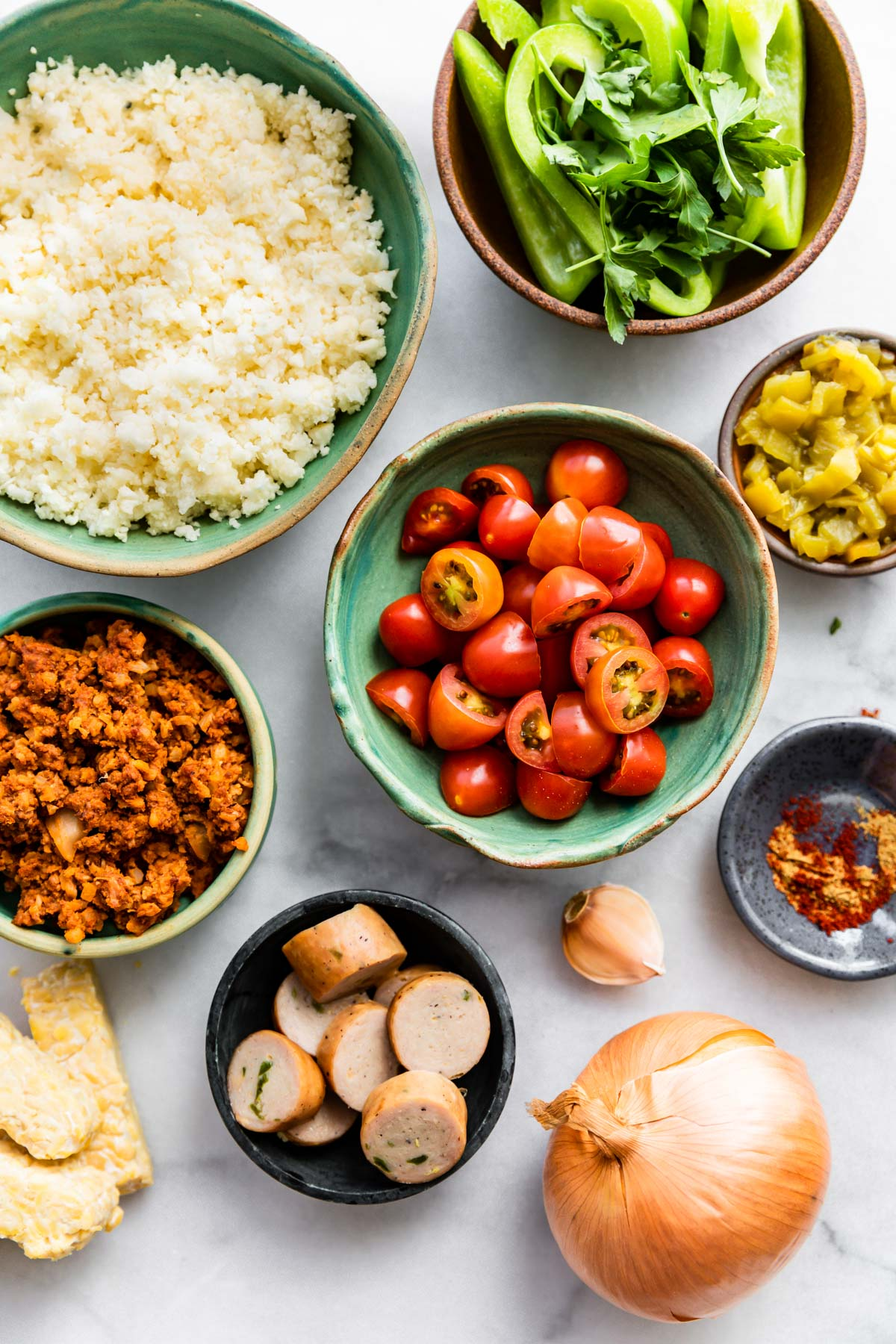 small bowls of ingredients to make Mexican cauliflower rice recipe