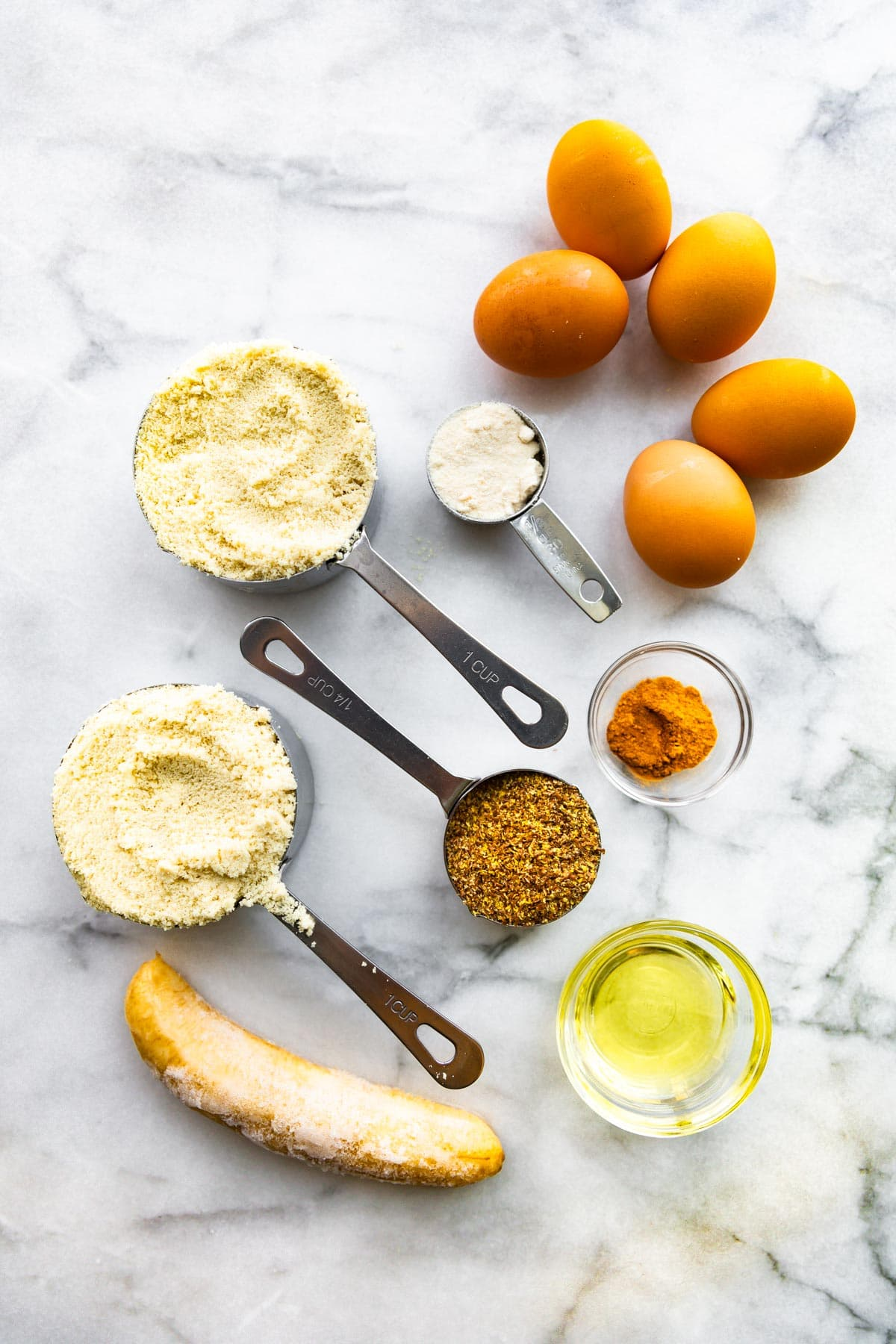 5 eggs and other ingredients in measuring cups for keto banana bread recipe