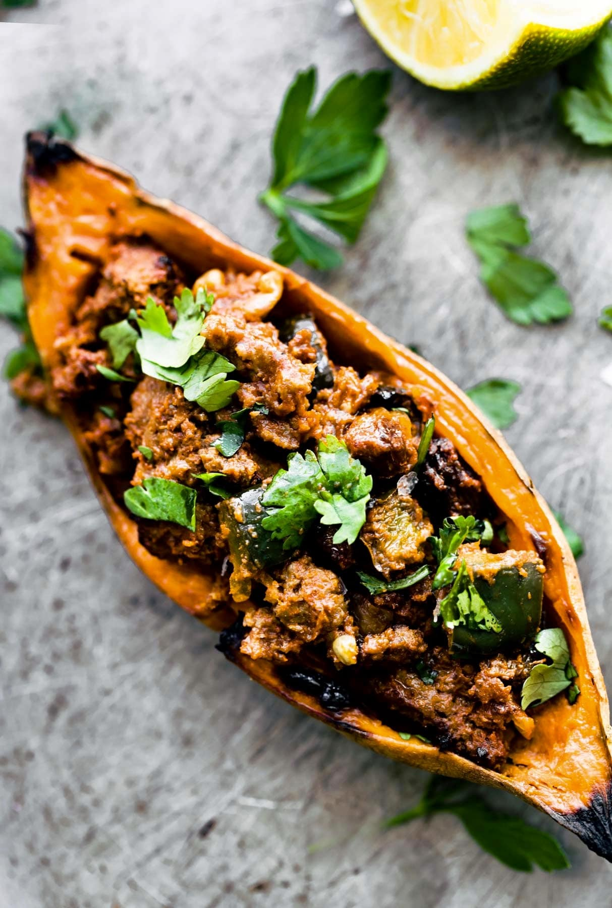 overhead photo: sweet potato skin appetizer, filled with lean beef chili