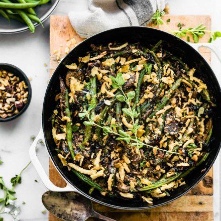 overhead image: vegan green bean casserole in a skillet