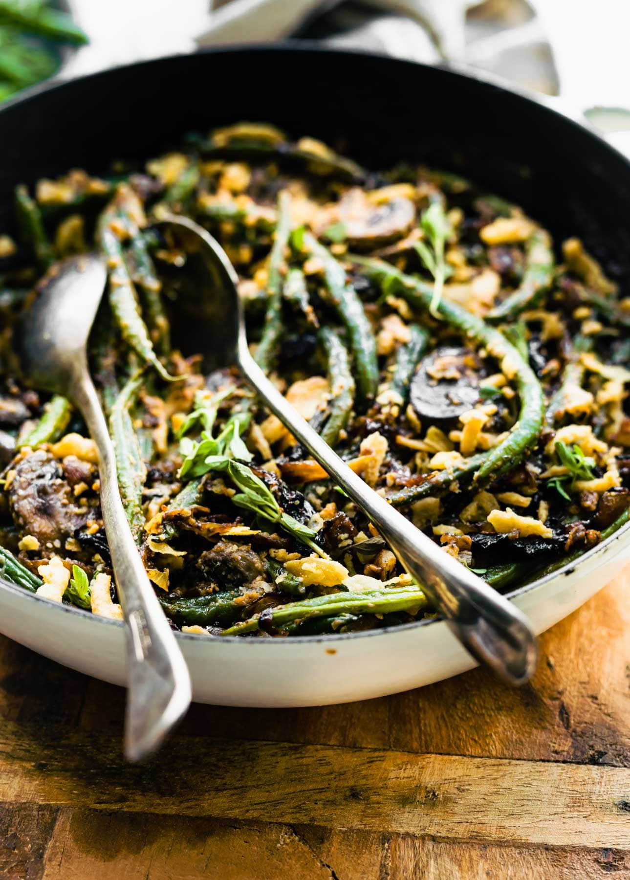 serving homemade vegan green bean casserole from a skillet