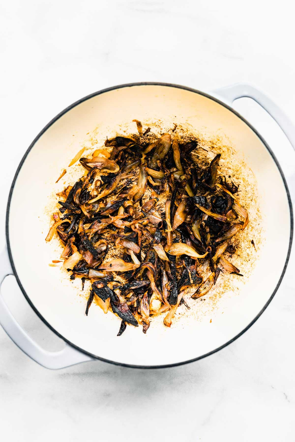 overhead photo: crispy fried shallots in white bowl