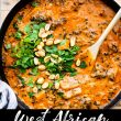 west african peanut stew on wood cutting board