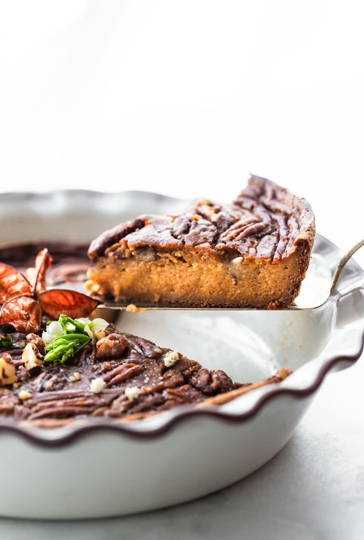 side view closeup: slice of crustless sweet potato pie on pie serving spatula
