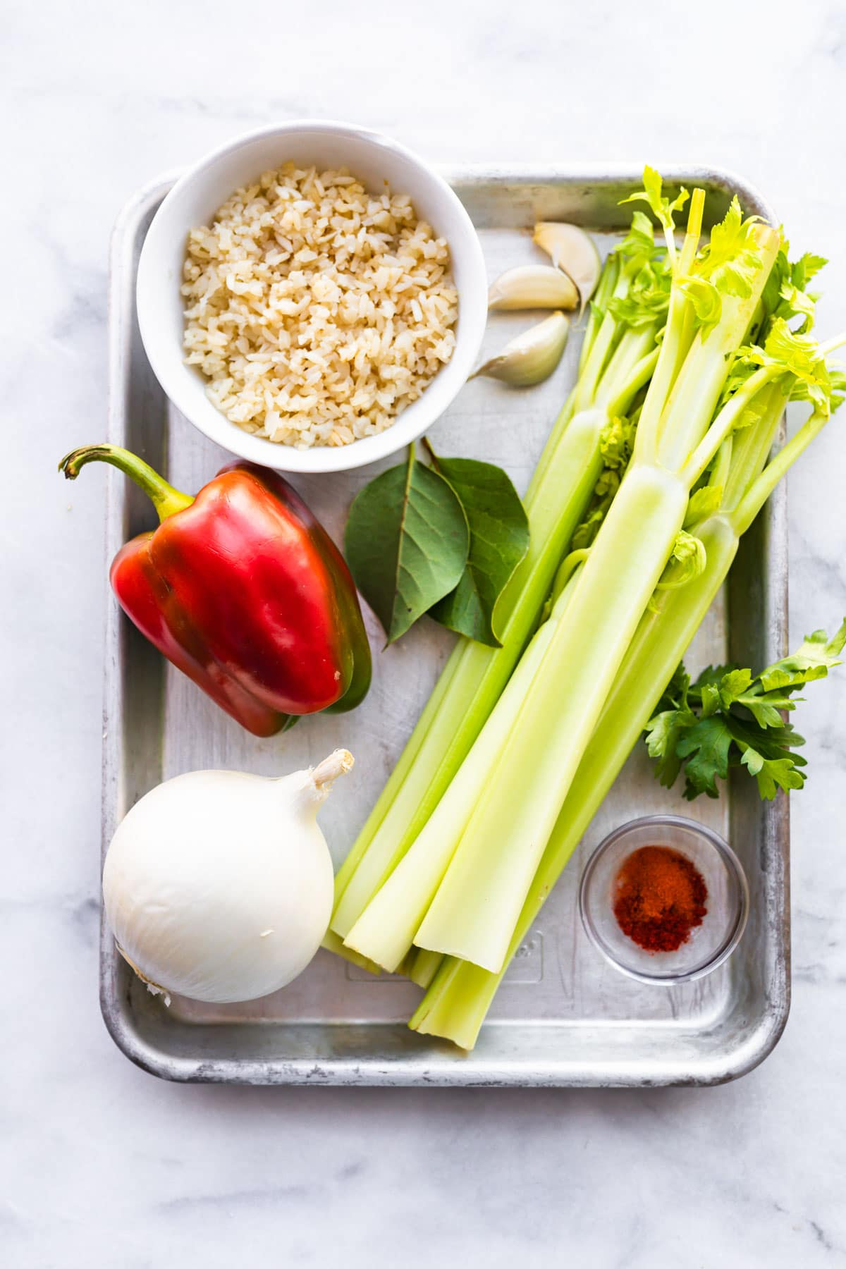 ingredients on a sheet pan to make gluten-free turkey rice soup recipe