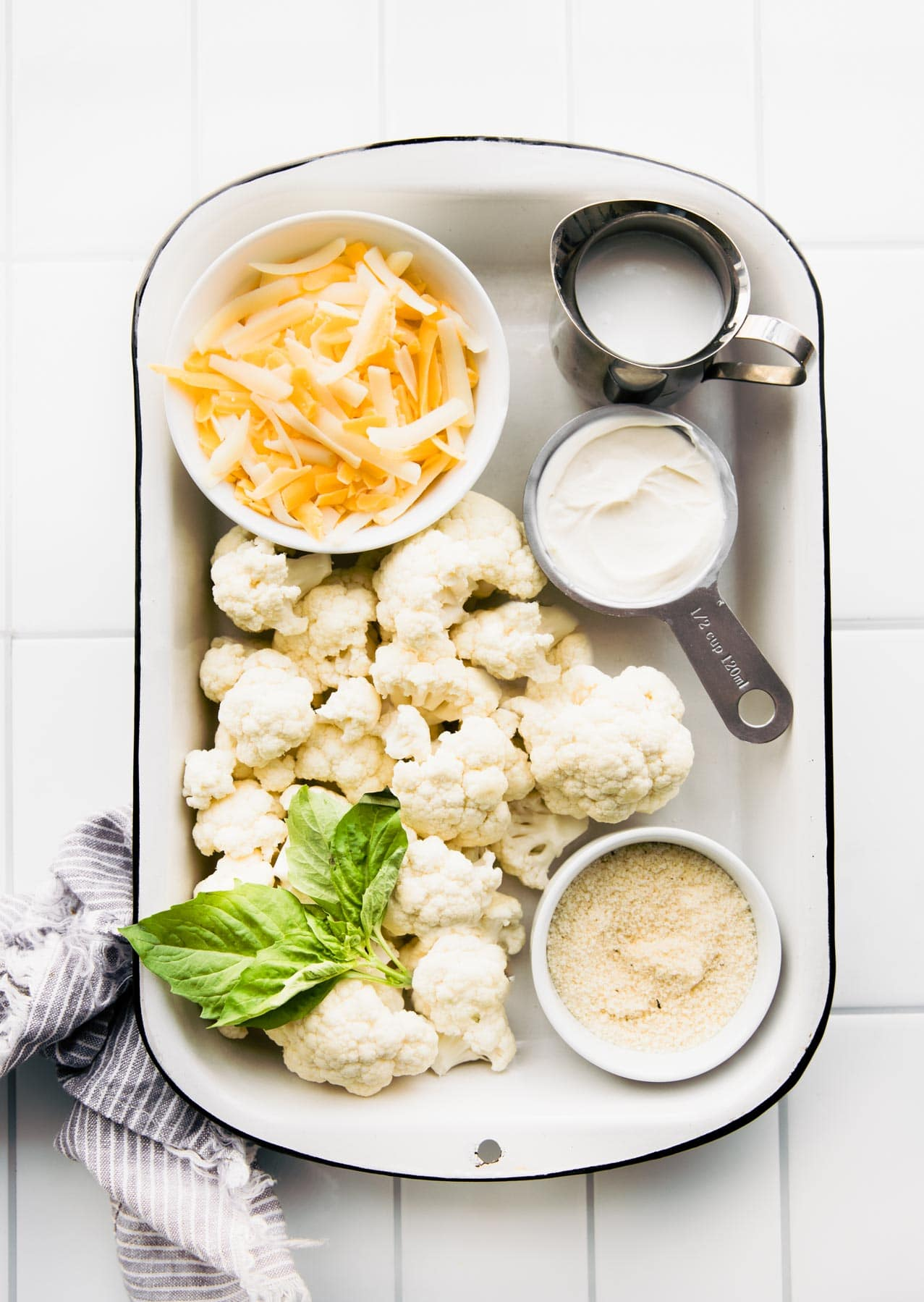ingredients on a tray to make cauliflower mac and cheese recipe