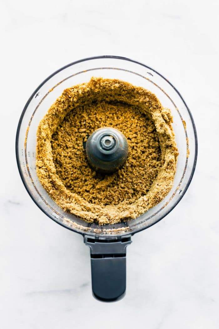 overhead photo: sunflower seed butter in bowl of food processor