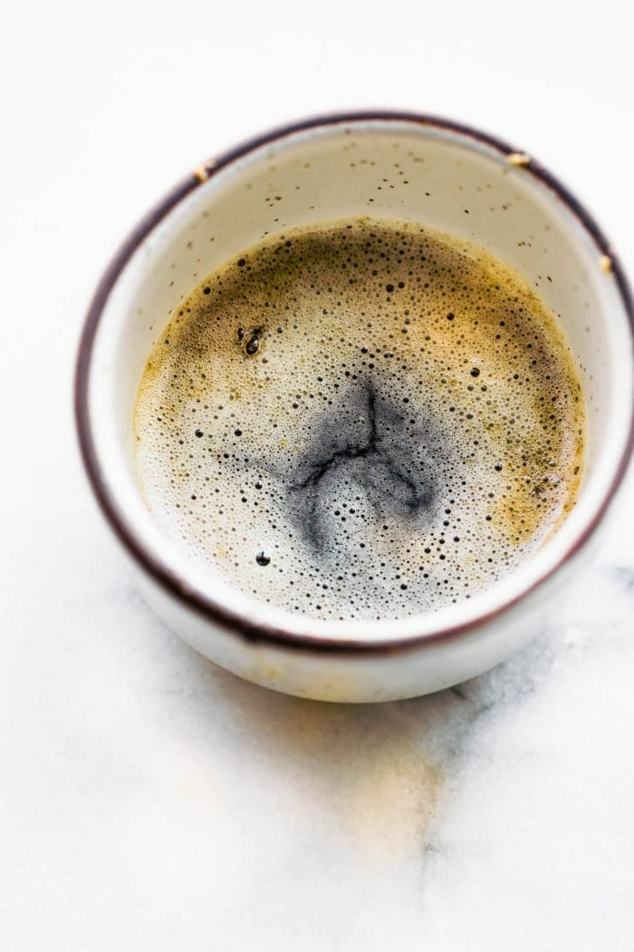 overhead photo: browned butter in a coffee mug