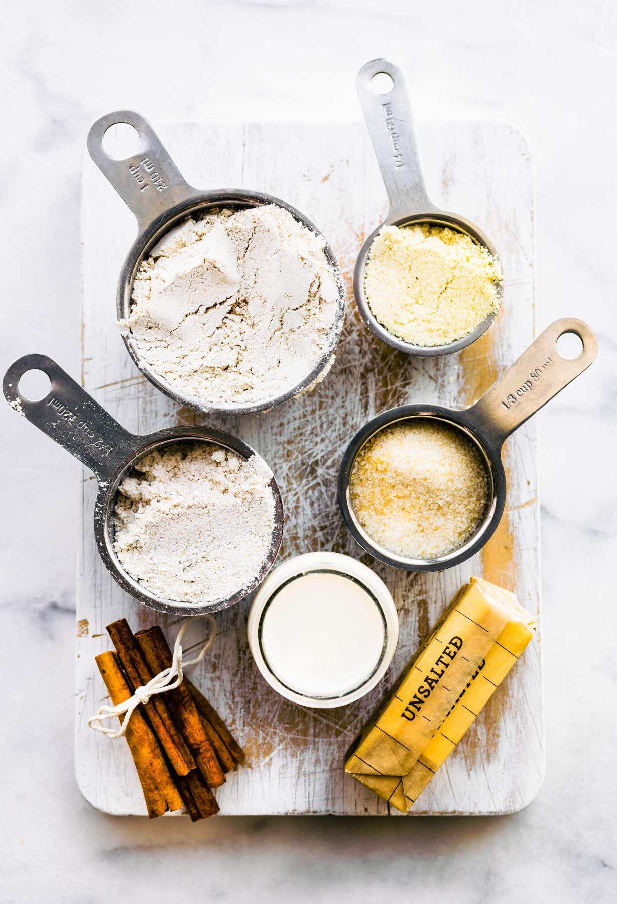 overhead photo: ingredients in measuring cups to make gluten free snickerdoodles