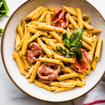 bowl of gluten free penne with creamy dairy free tomato sauce