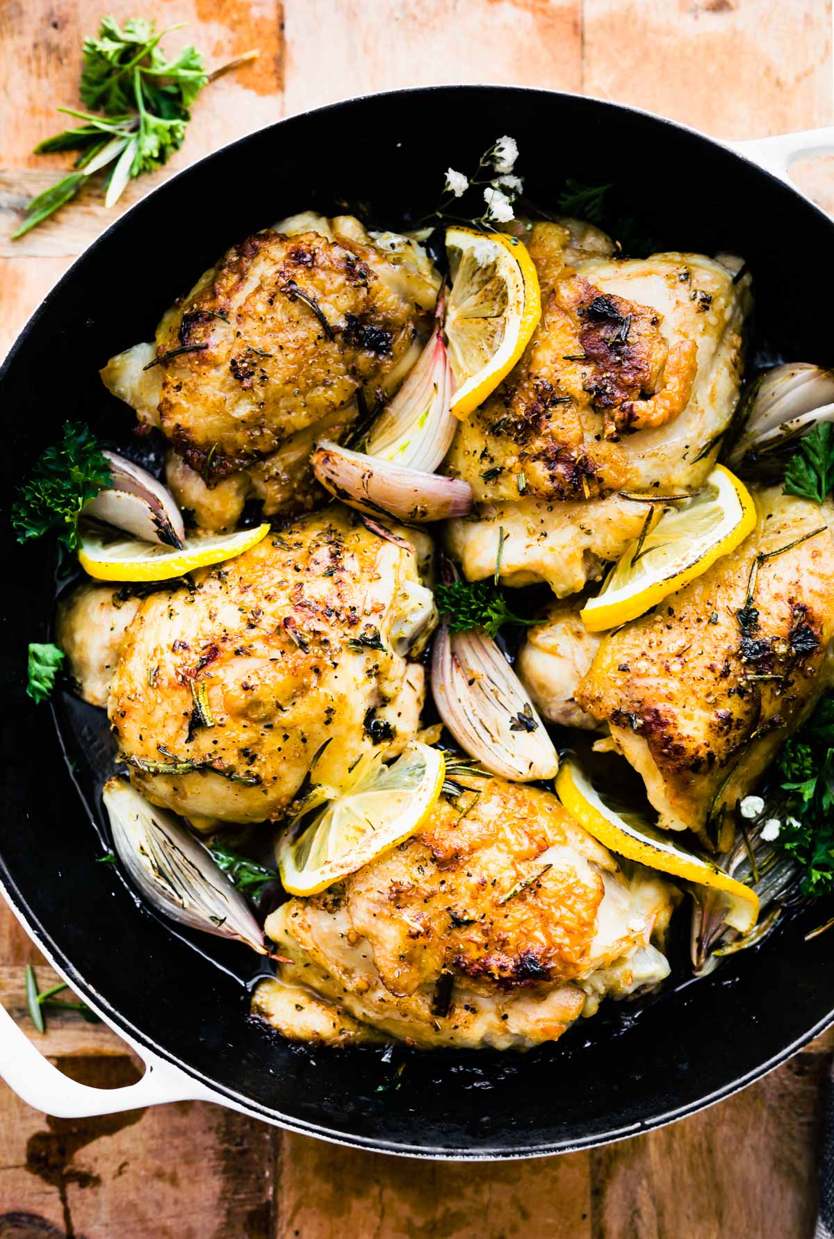 overhead image: herb roasted chicken thighs in skillet