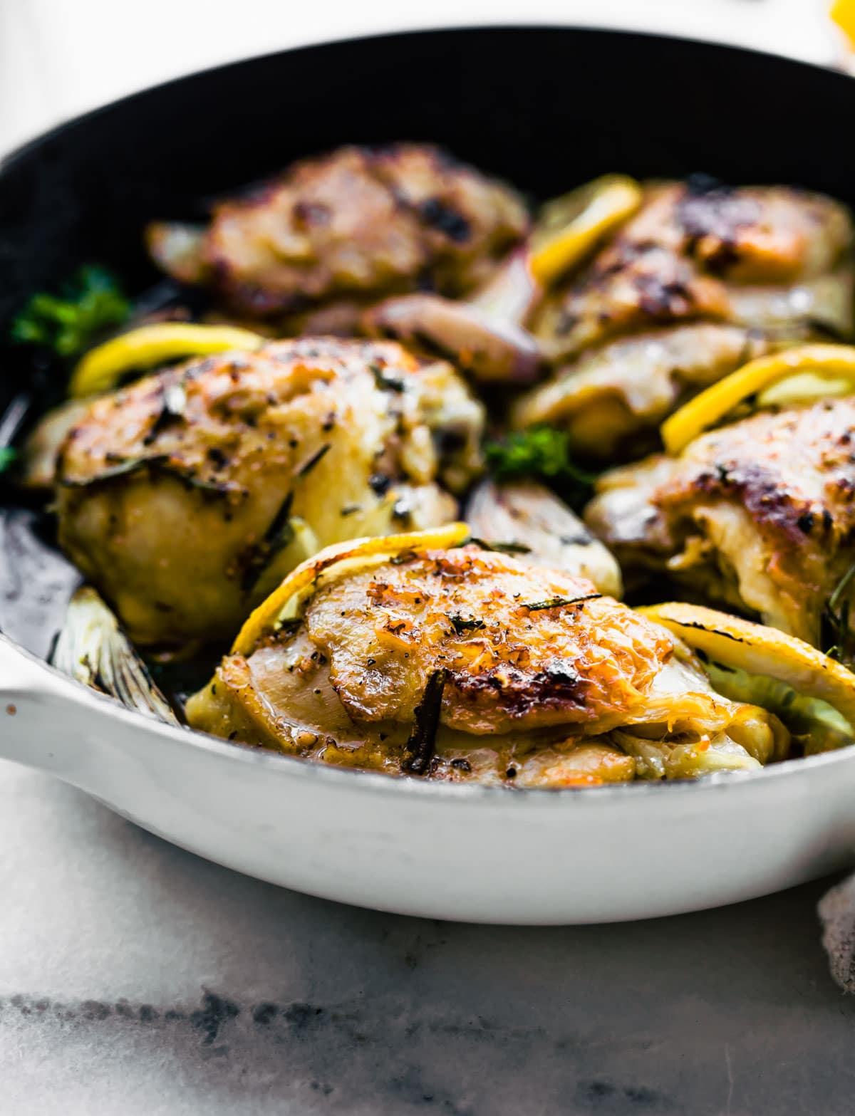 healthy baked chicken recipe cooking in a skillet