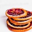stack of dried orange slices on white background
