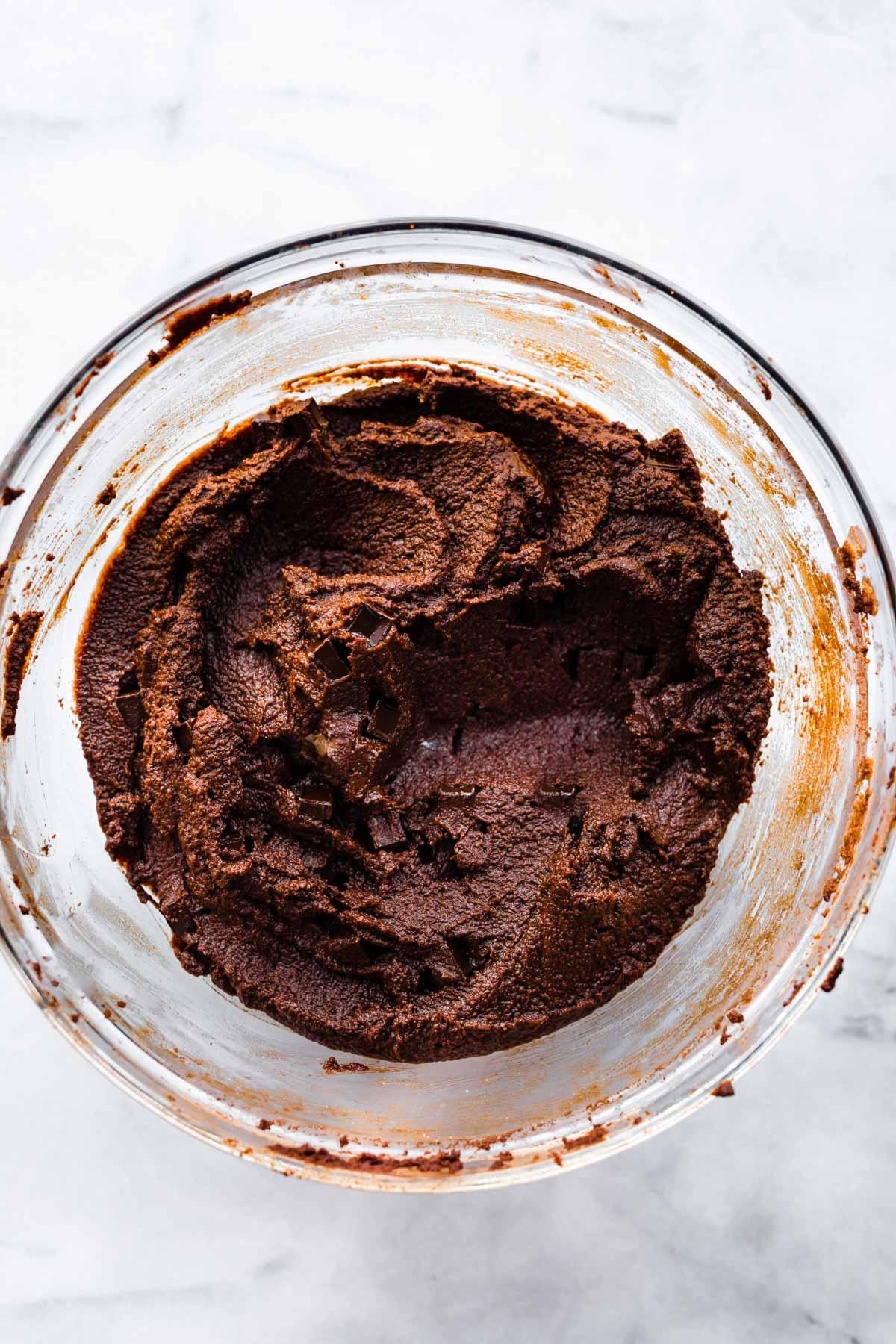 overhead image: glass bowl of vegan brownie batter