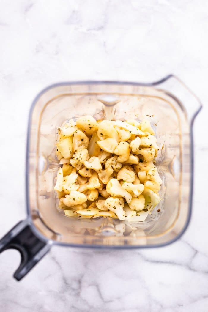 combining cauliflower alfredo sauce ingredients in blender