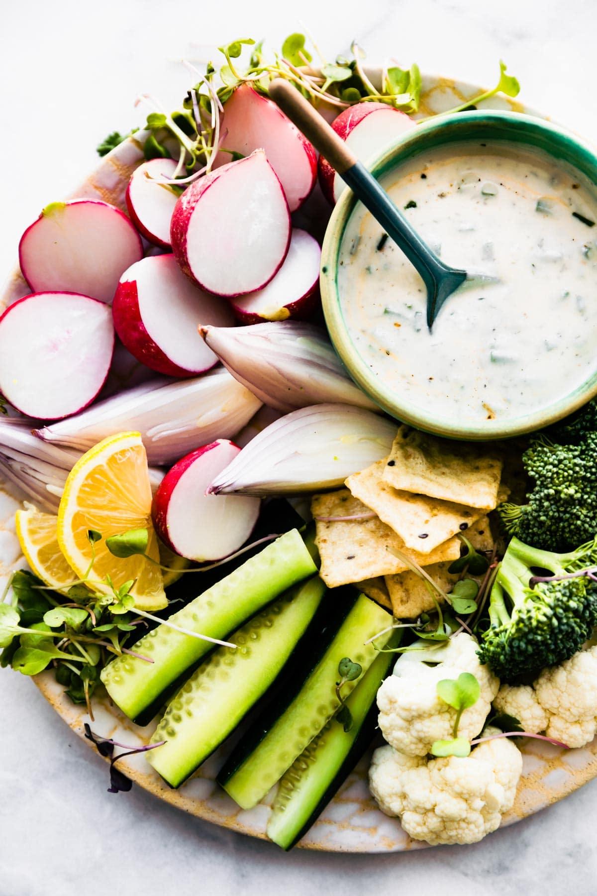 fresh vegetables and vegan veggie dip on snack platter