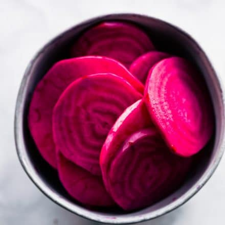 overhead image: slices of red beets in a small bowl