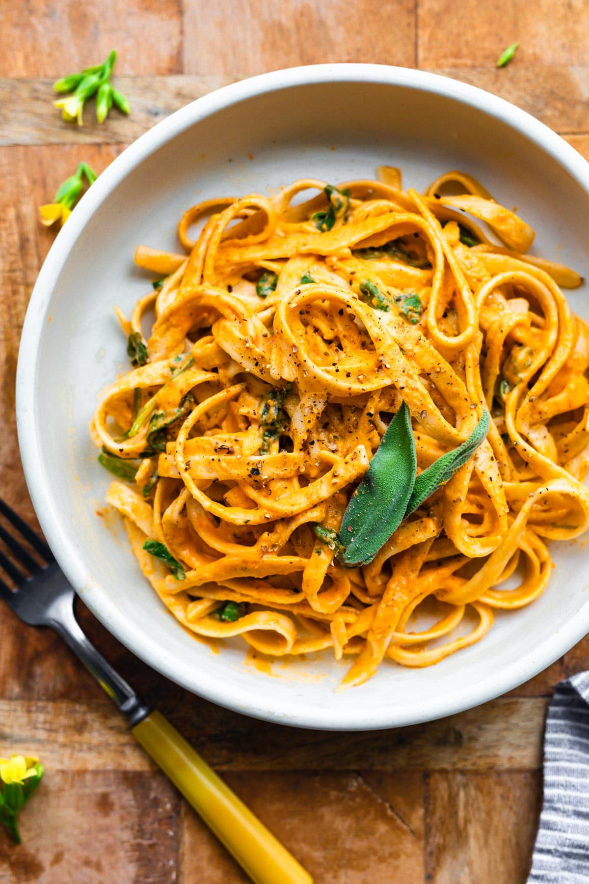 overhead: plated gluten free pasta dinner with roasted red pepper sauce