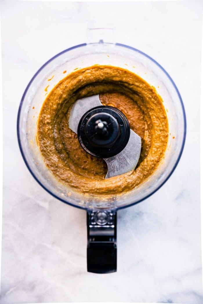making almond mocha fudge in bowl of food processor