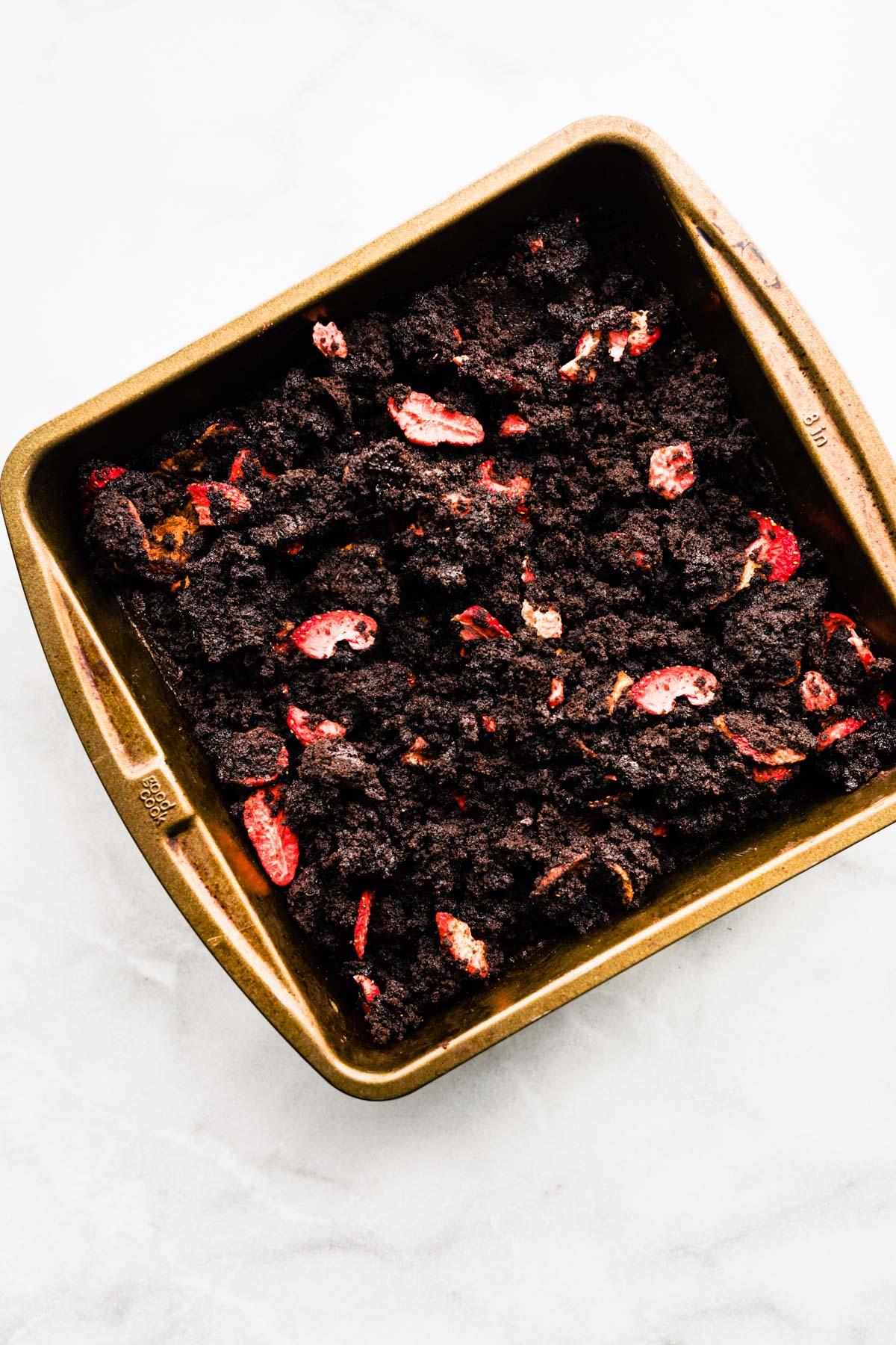 overhead: pan of grain free brownies with strawberries