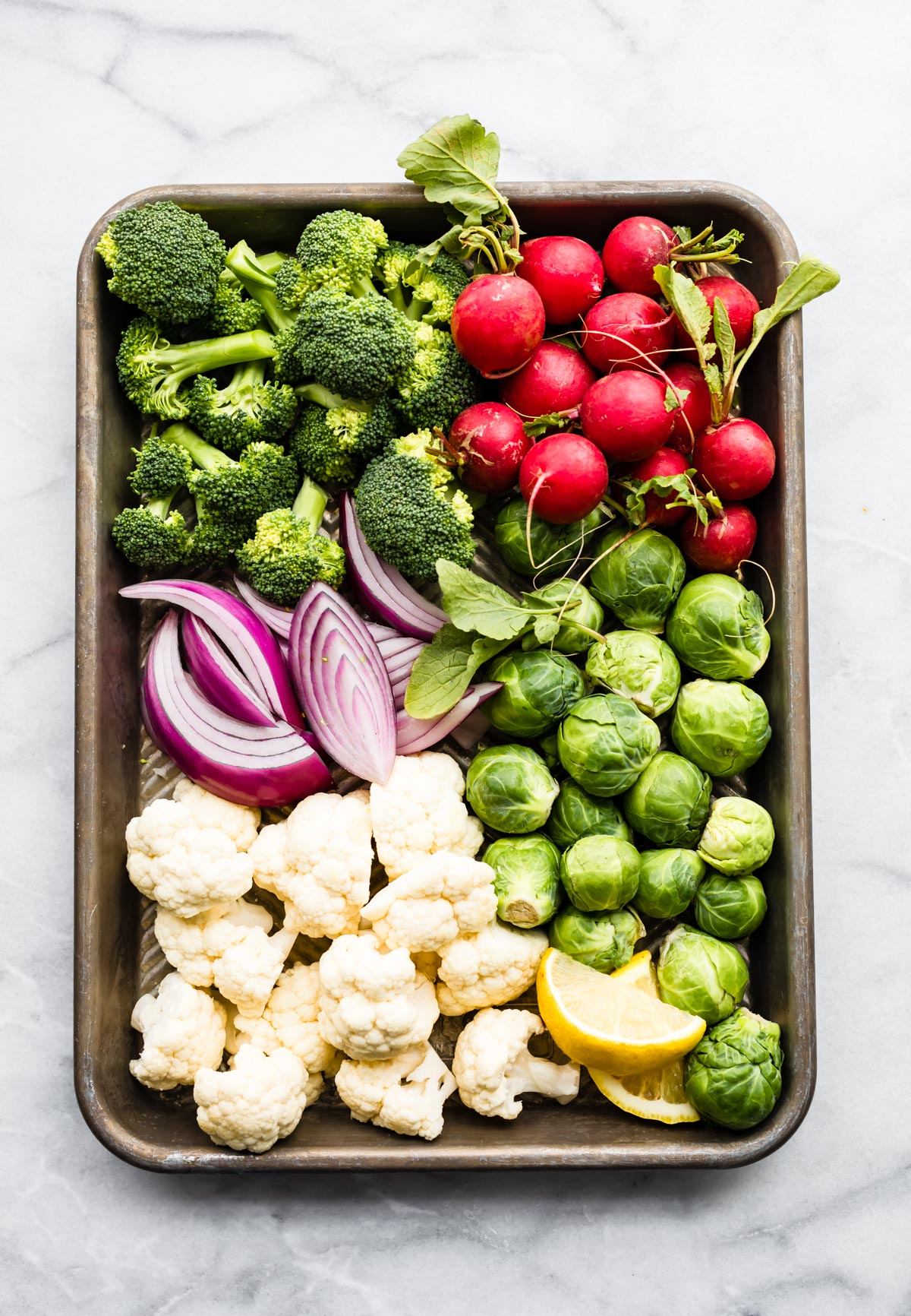 sheet pan of raw vegetables to be cooked in air fryer