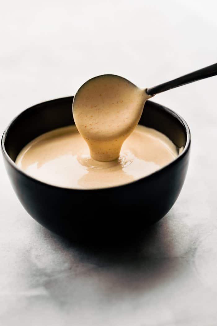 refined sugar free healthy yum yum sauce on ladle in bowl