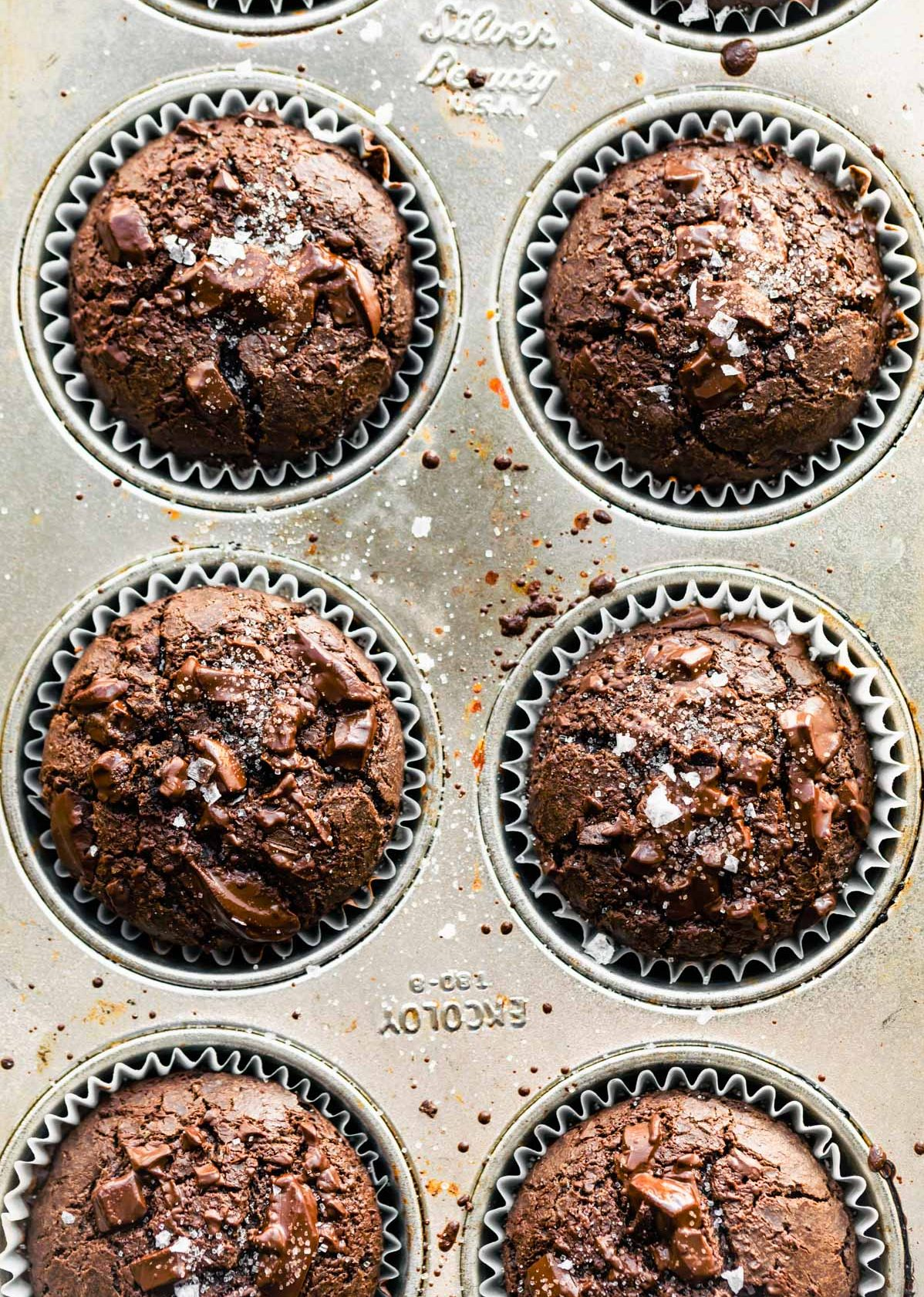 overhead shot of chocolate gluten free muffins baked in muffin pan