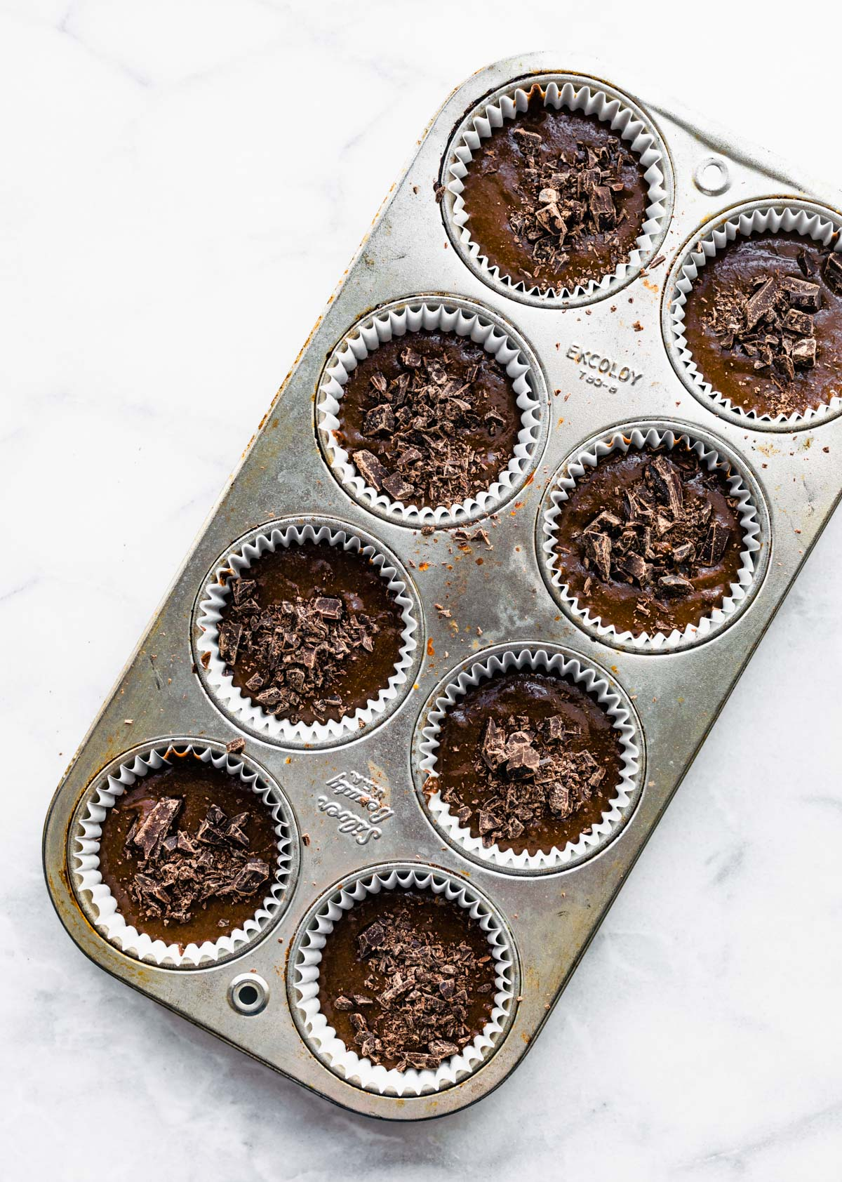 overhead photo: unbaked muffin batter in baking pan