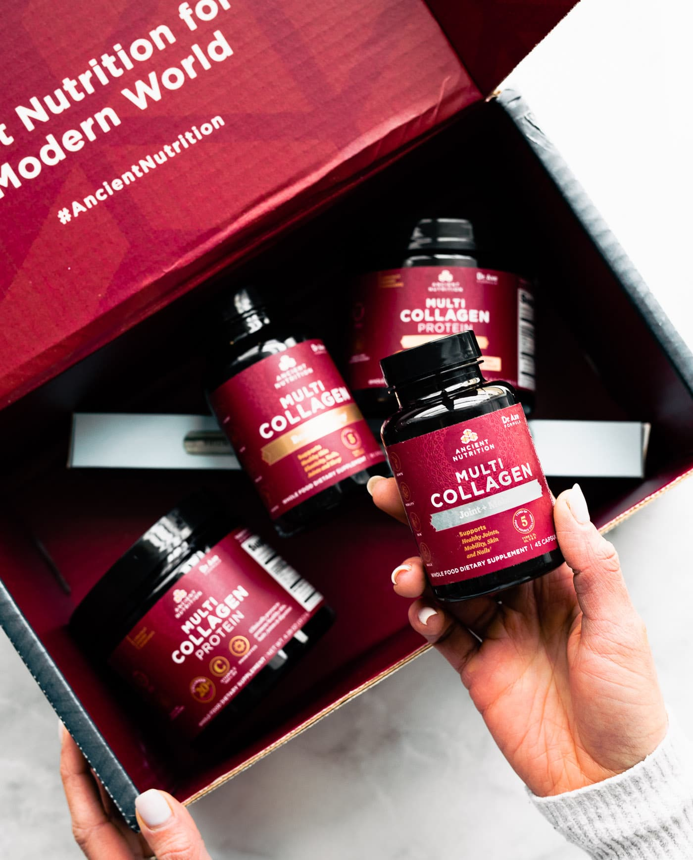 bottles of Ancient Nutrition brand multi collagen protein products