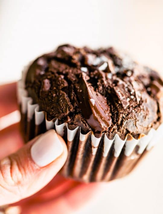 woman's hand holding a Mexican chocolate vegan muffin