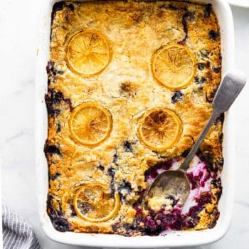 Overhead image: Cooked lemon blueberry cake in baking dish