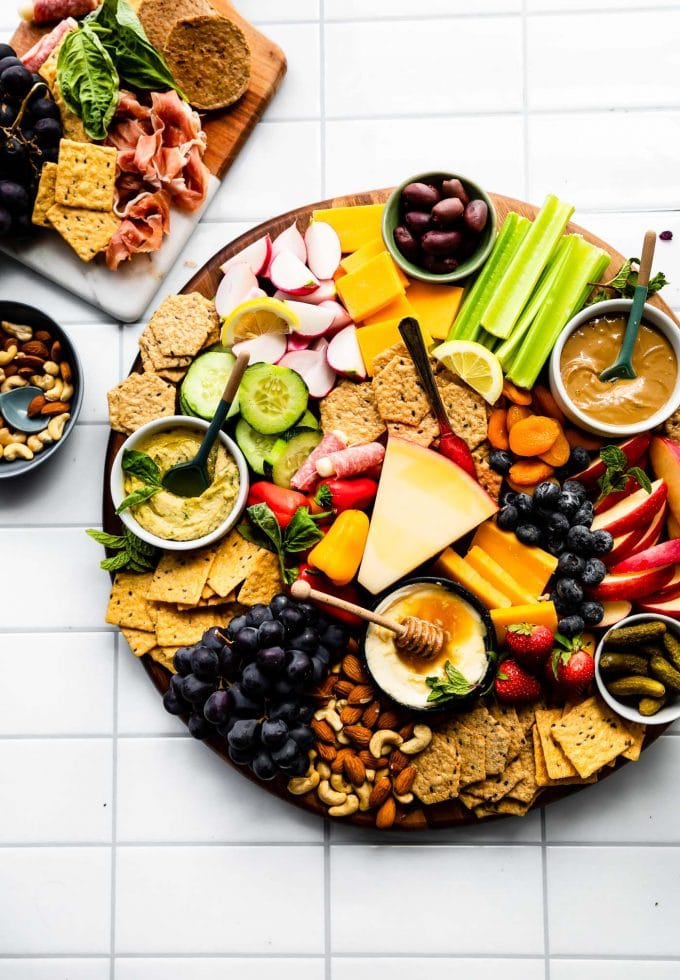 Overhead image of snack trays on a white tile tabletop.