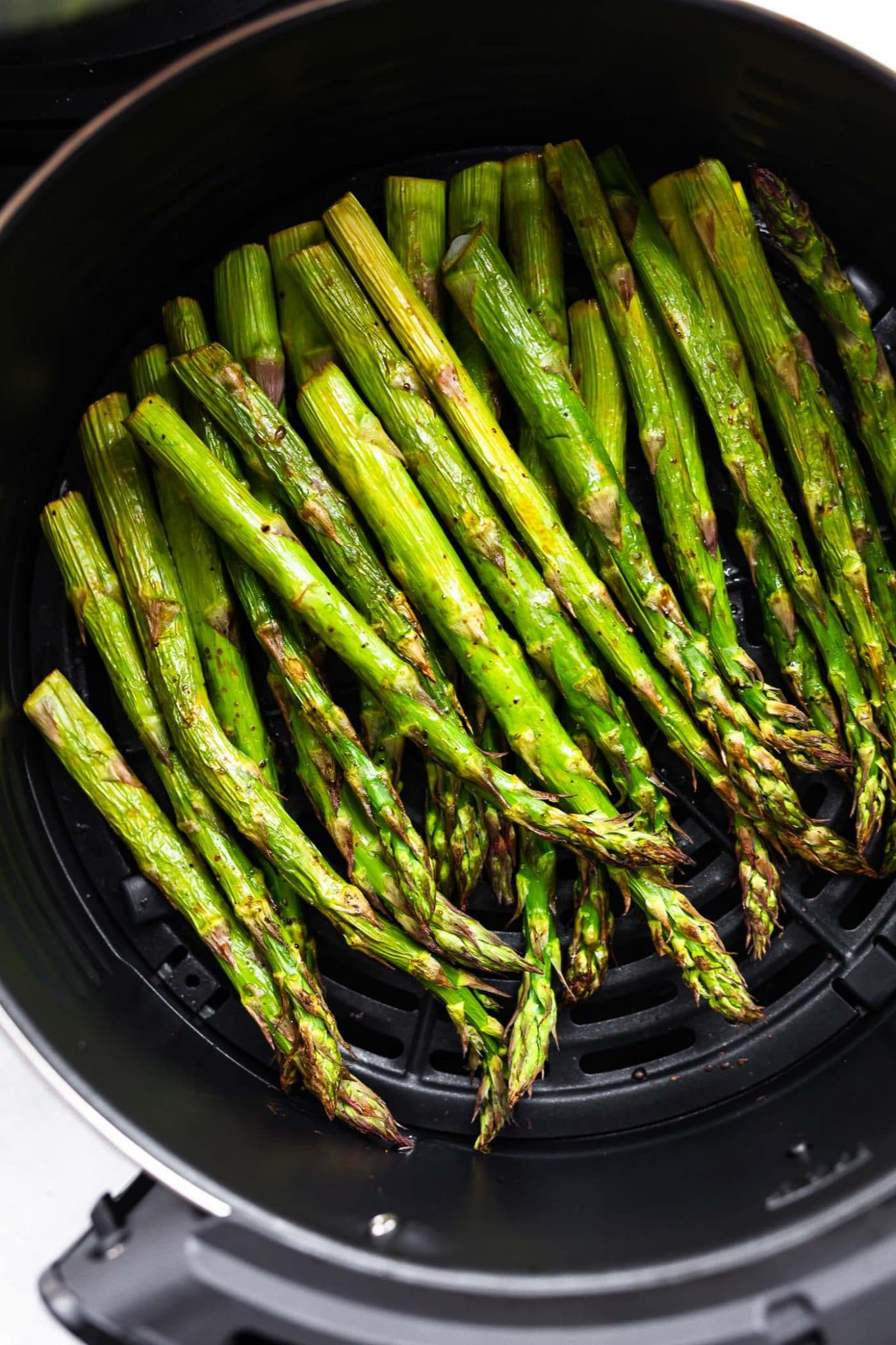 Overhead image of Roasted Air Fryer Asparagus in the air fryer.