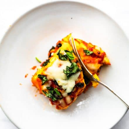 One prepared keto egg lasagna roll up served on a plate
