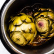 overhead photos of cooked artichokes in an instant pot. Pressure cooked artichokes with lid off the pot