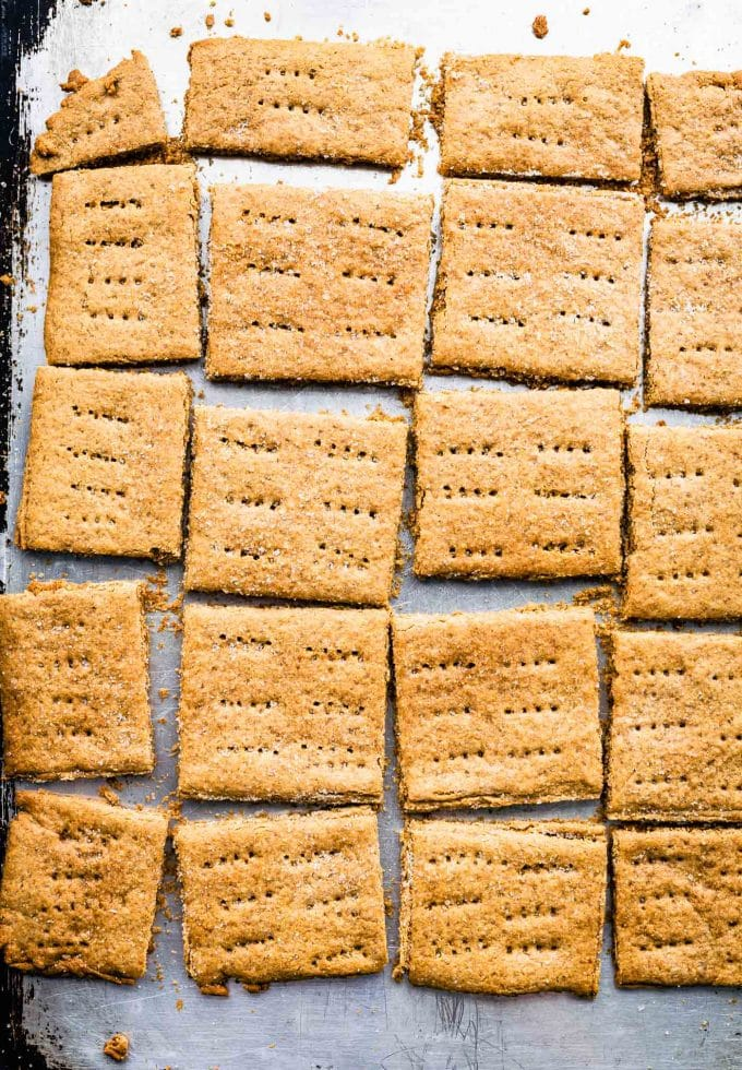 Overhead image of homemade graham crackers on a sheet pan.