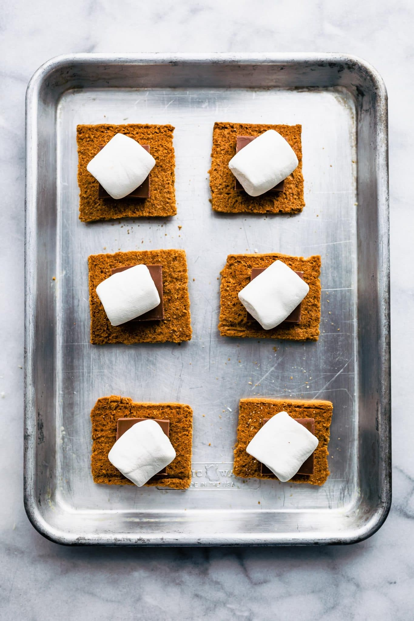 Overhead image of vegan oven-baked s'mores on a small toaster oven sheet pan.