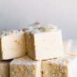A close up image of stacked homemade coconut marshmallows.
