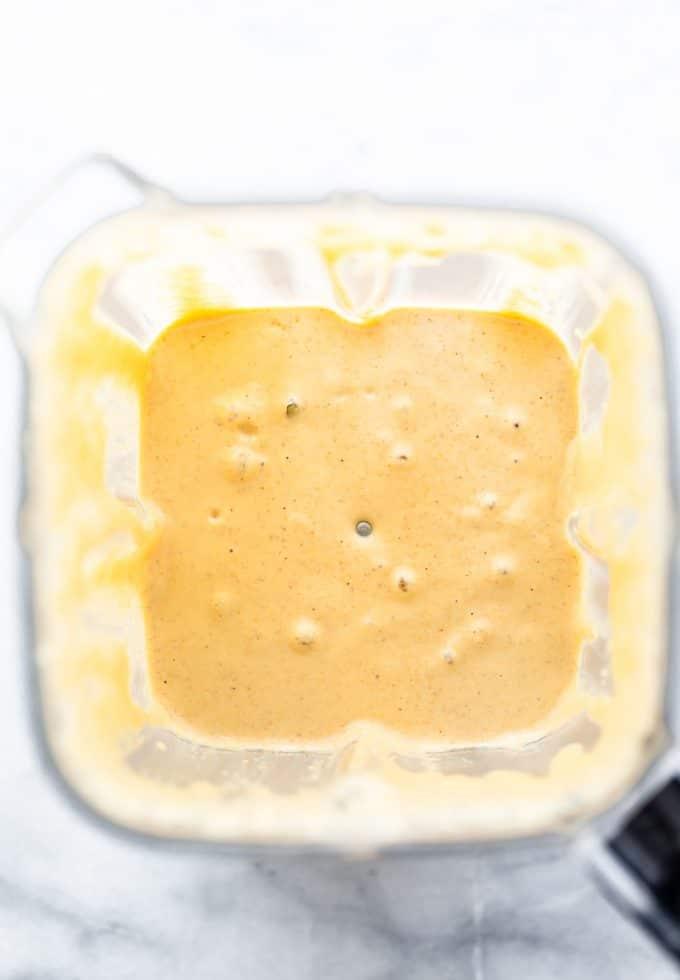 Overhead image of pancake batter in a blender.
