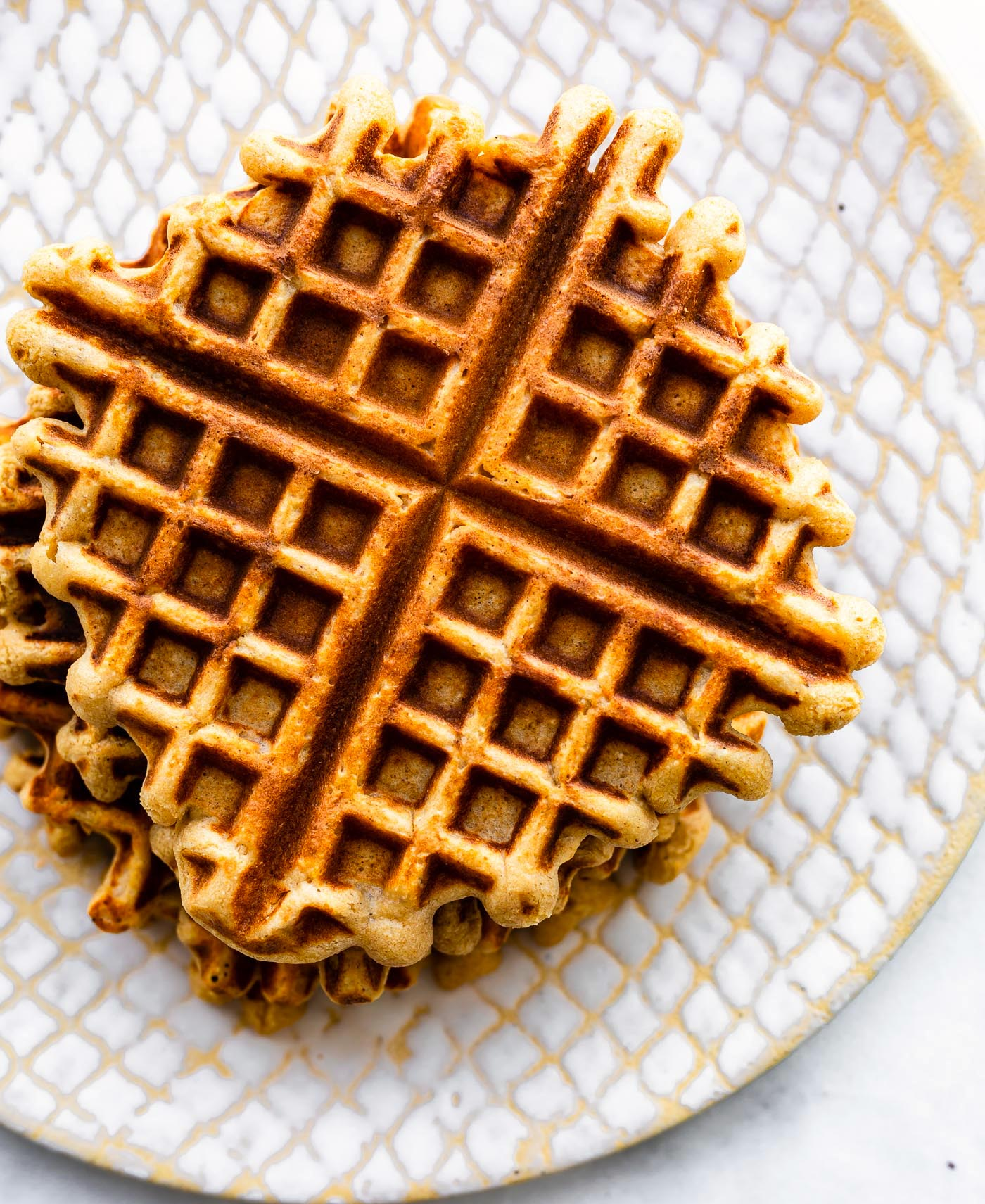 Overhead image of peanut butter waffles on a plate.