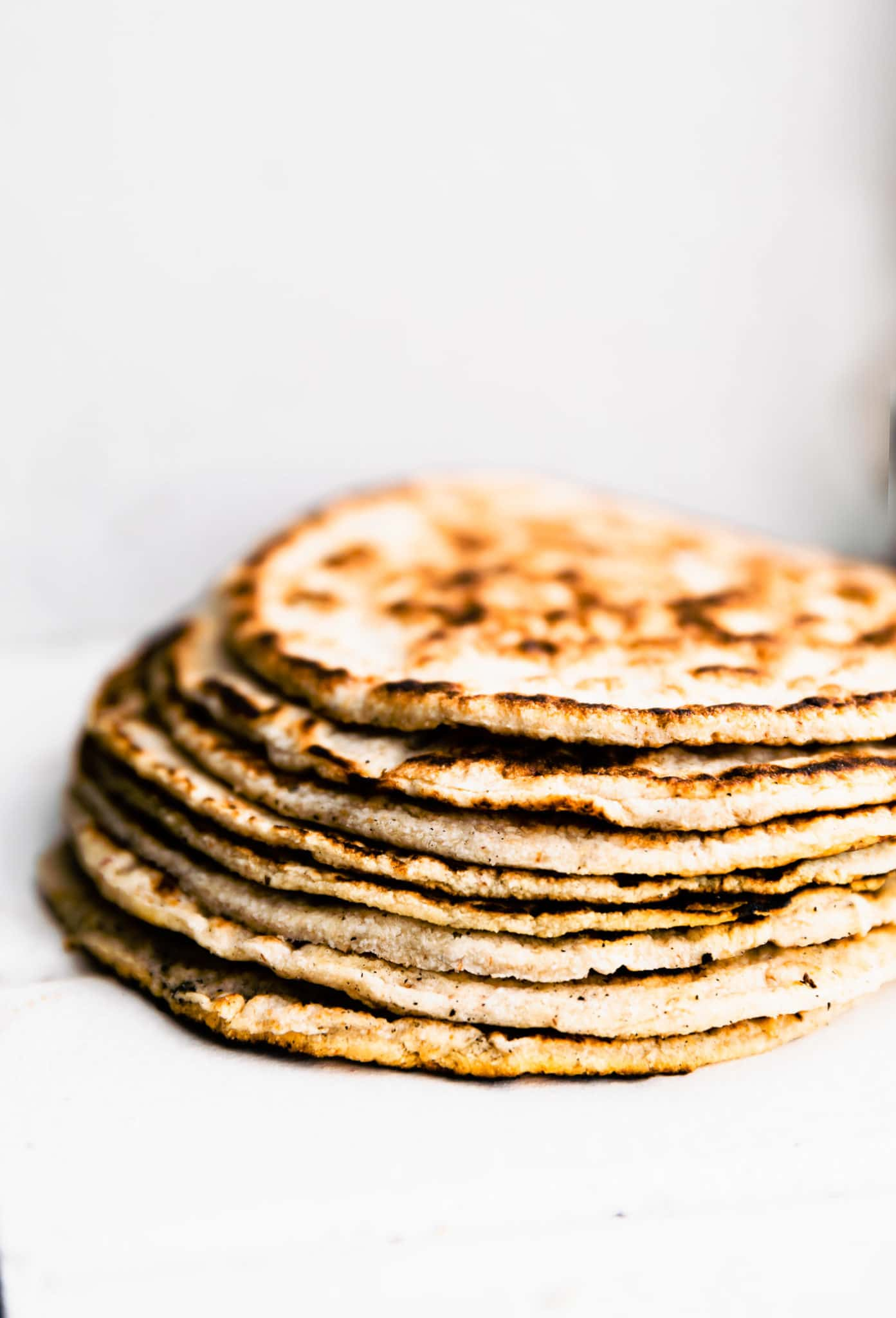 Side image of a stack of gluten free tortillas.