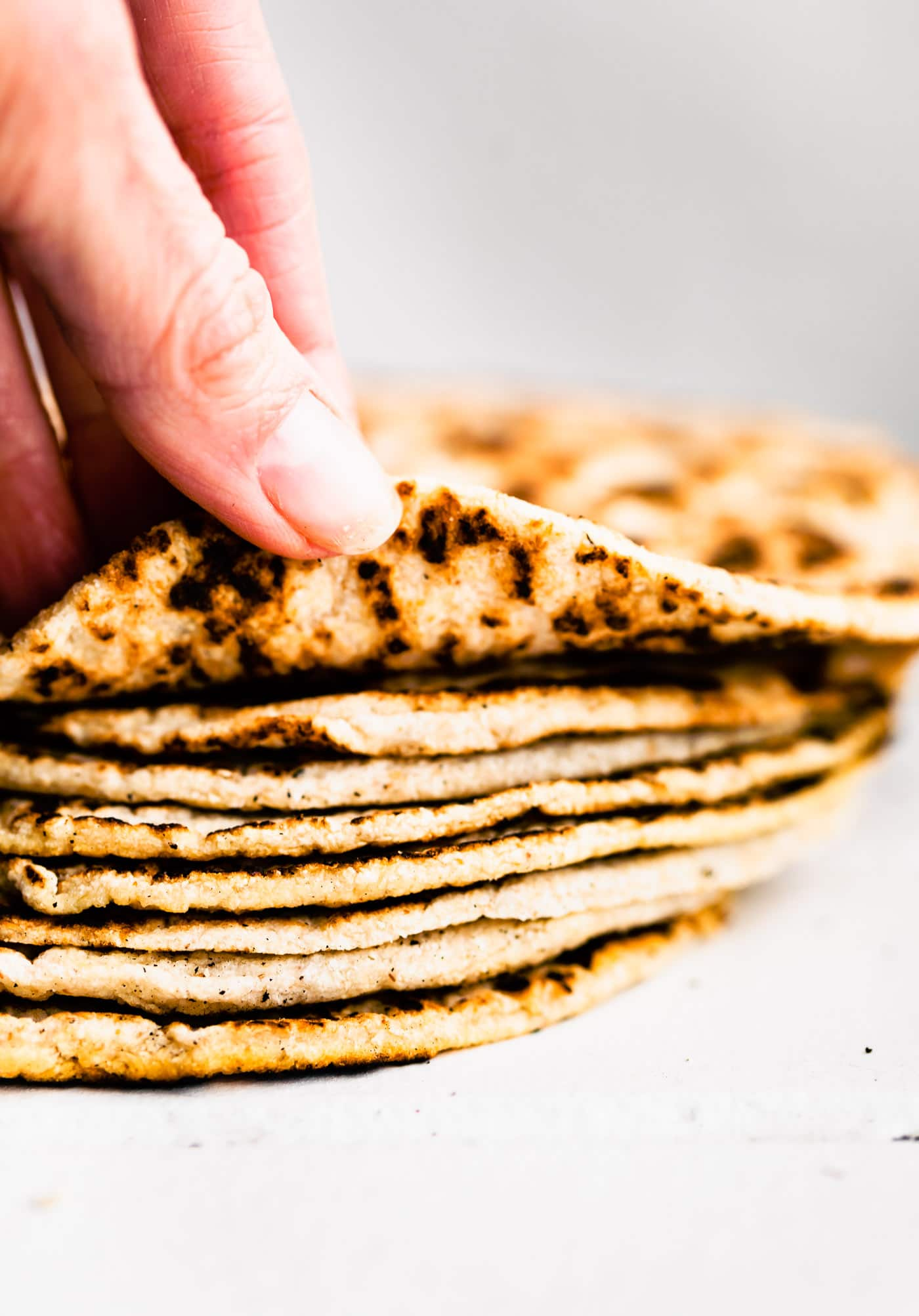 Side image of a stack of homemade coconut flour tortillas