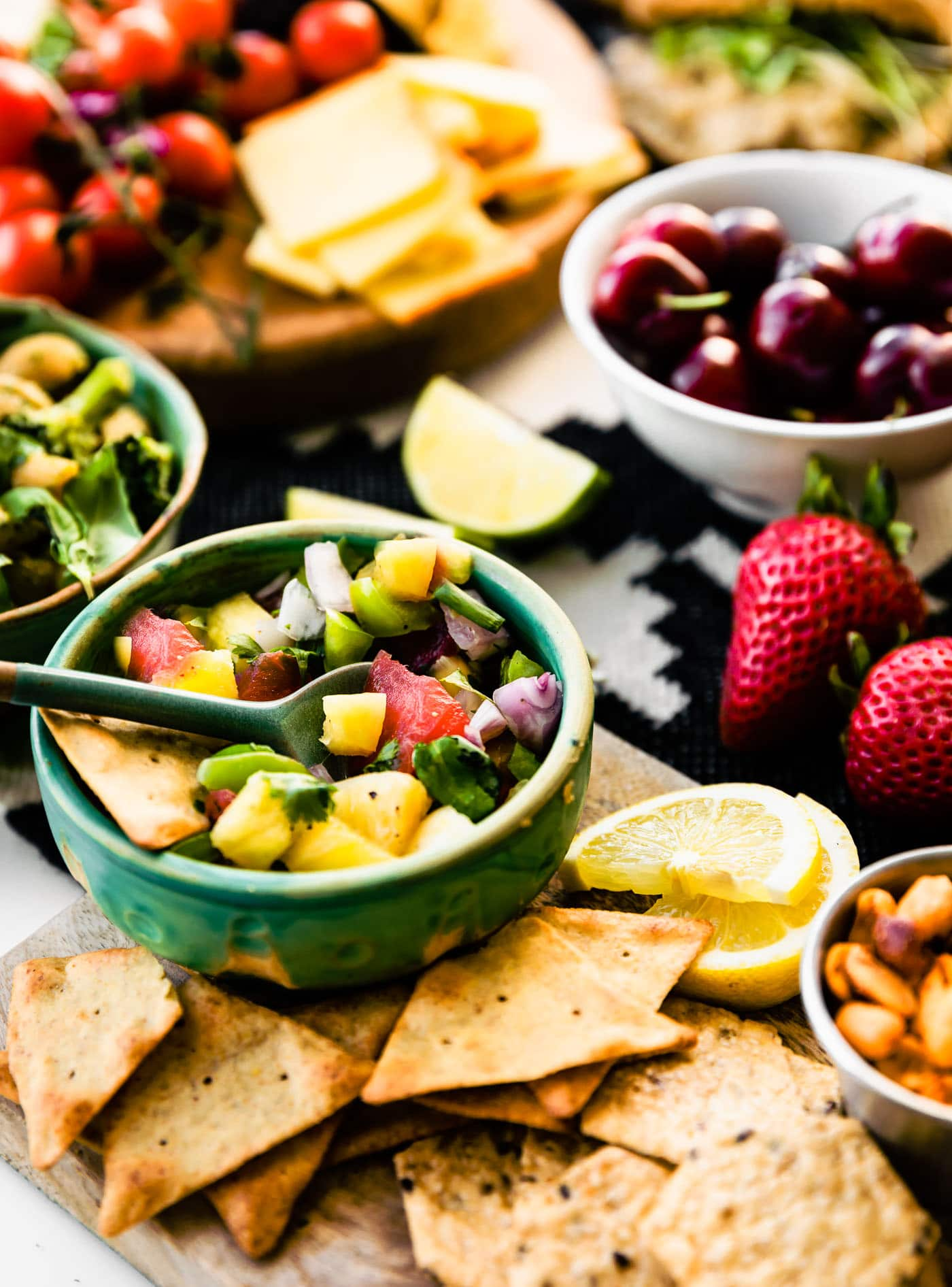 Close up image of recipes included in the summer bbq graze board such as watermelon pineapple salsa