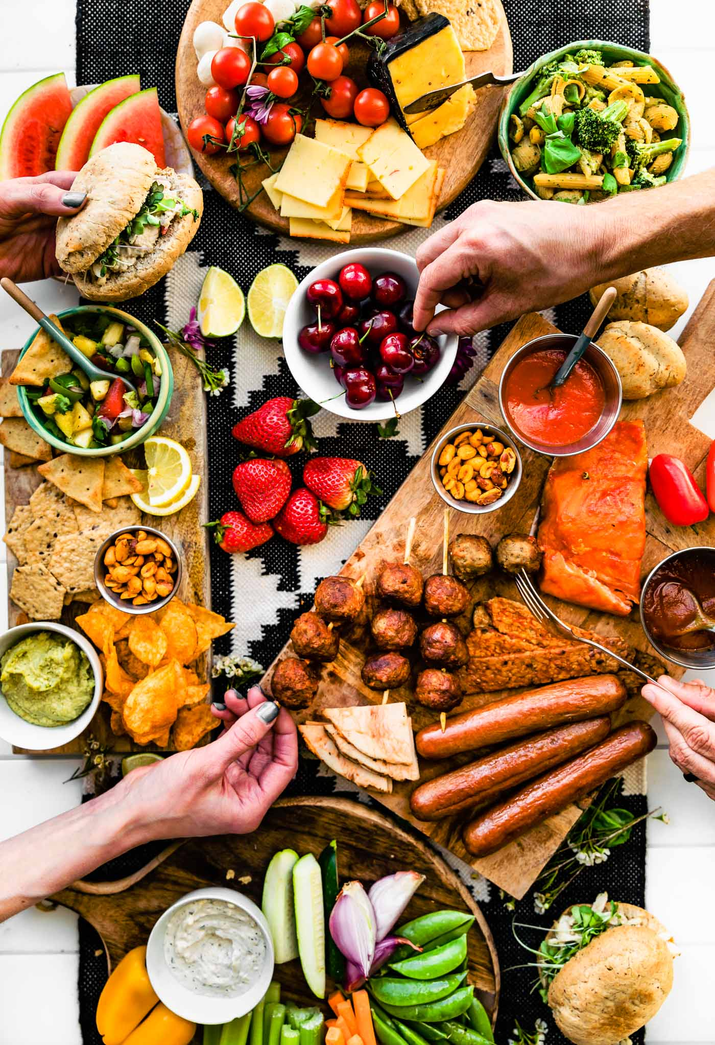 Overhead image of BBQ Graze Board with summer picnic and BBQ dishes